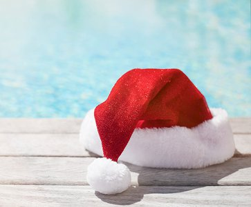 Take the Christmas spirit outside: Holiday decorations for your pool area